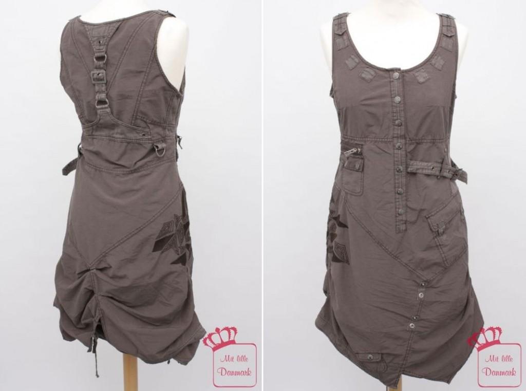 Bei jedem Blick entdeckt man etwas Neues: Das Kleid 3306-23 in der Farbe Grau (292) aus der Herbstkollektion 2012 von Nü by Staff-Woman.